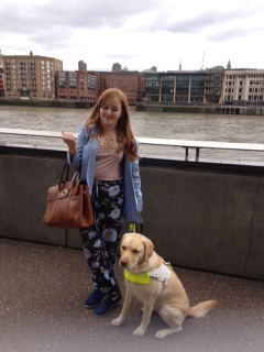 Long shot of my guide dog Unity and myself by the London River front
