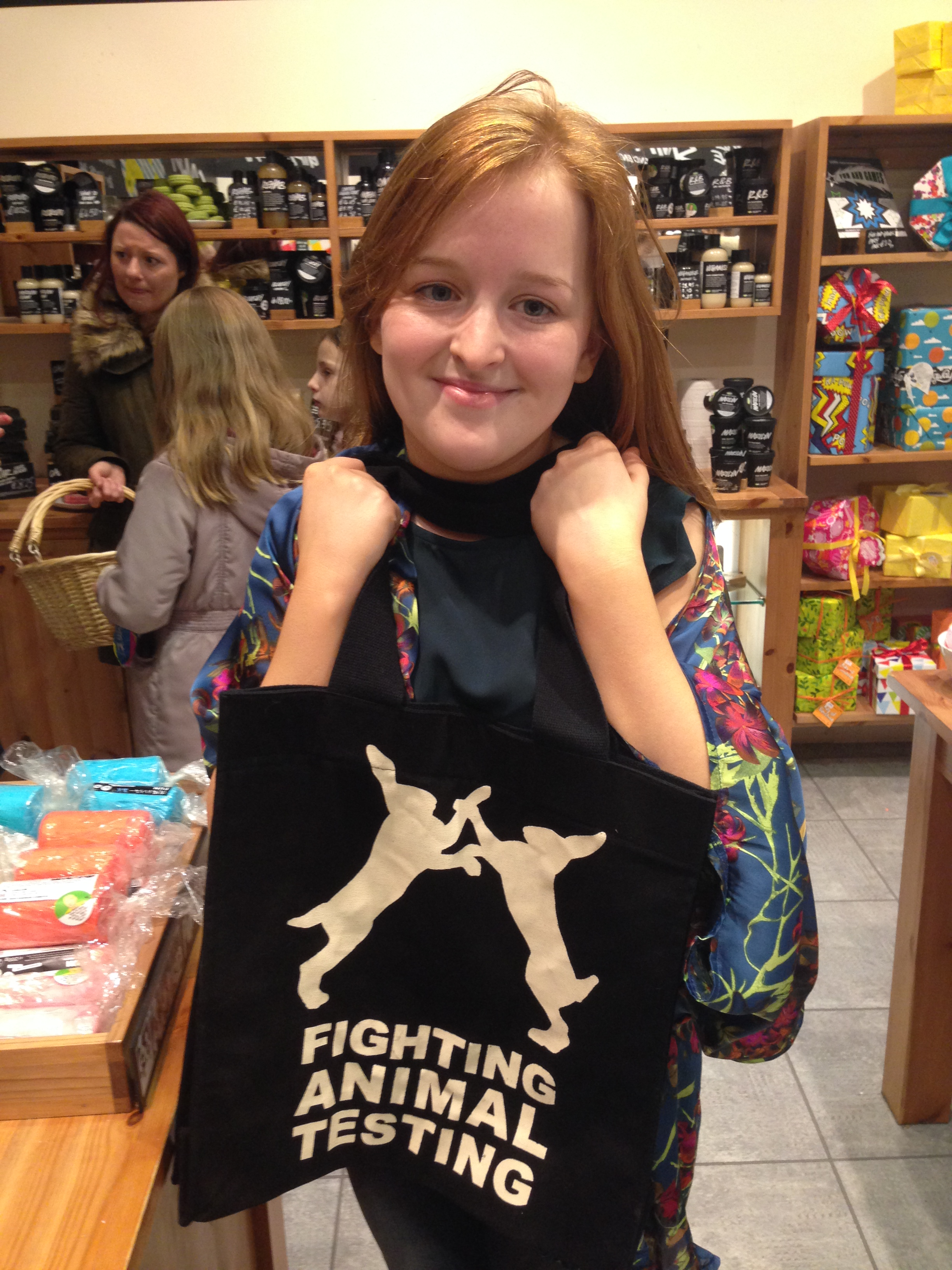 6411f756c8 An image of Fashioneyesta holding Lush s promotional black tote shopper  with the  Against Animal testing logo on the front