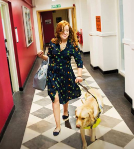 Emily with her guide dog Unity