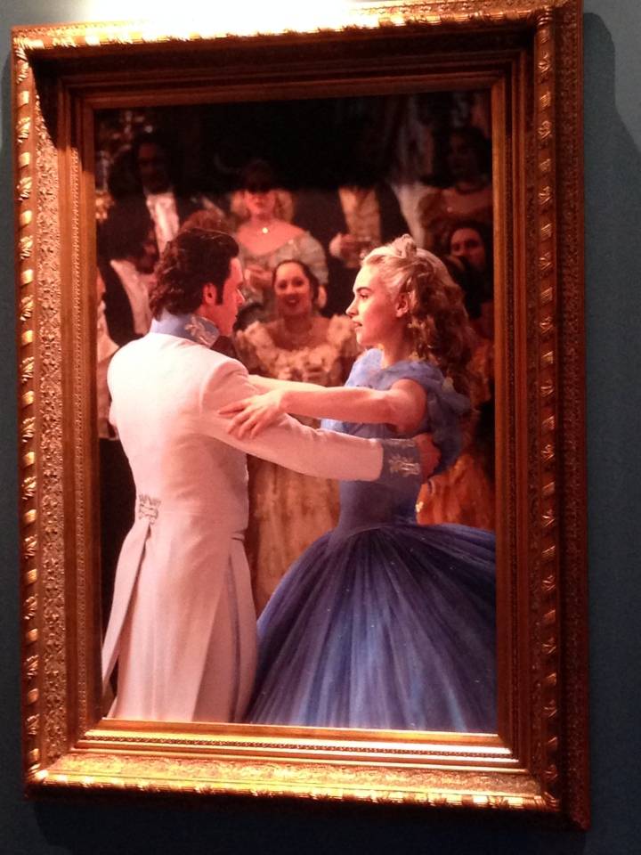 Image of a painting from the Cinderella film depicting Cinderella dancing with the Prince at the ball