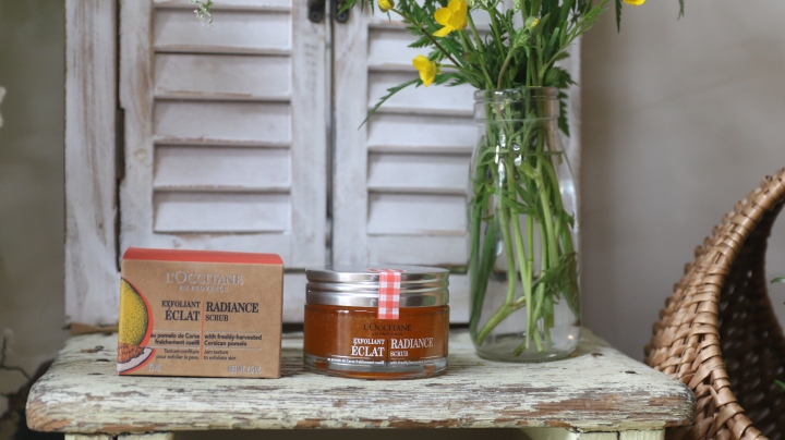 A macro shot of the Radiance Face Scrub on a rustic table.